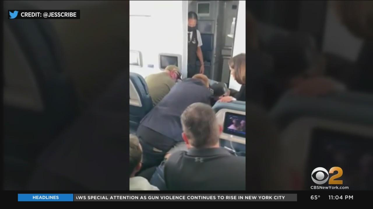 Man In Custody After Trying To Break Into Cockpit During Flight