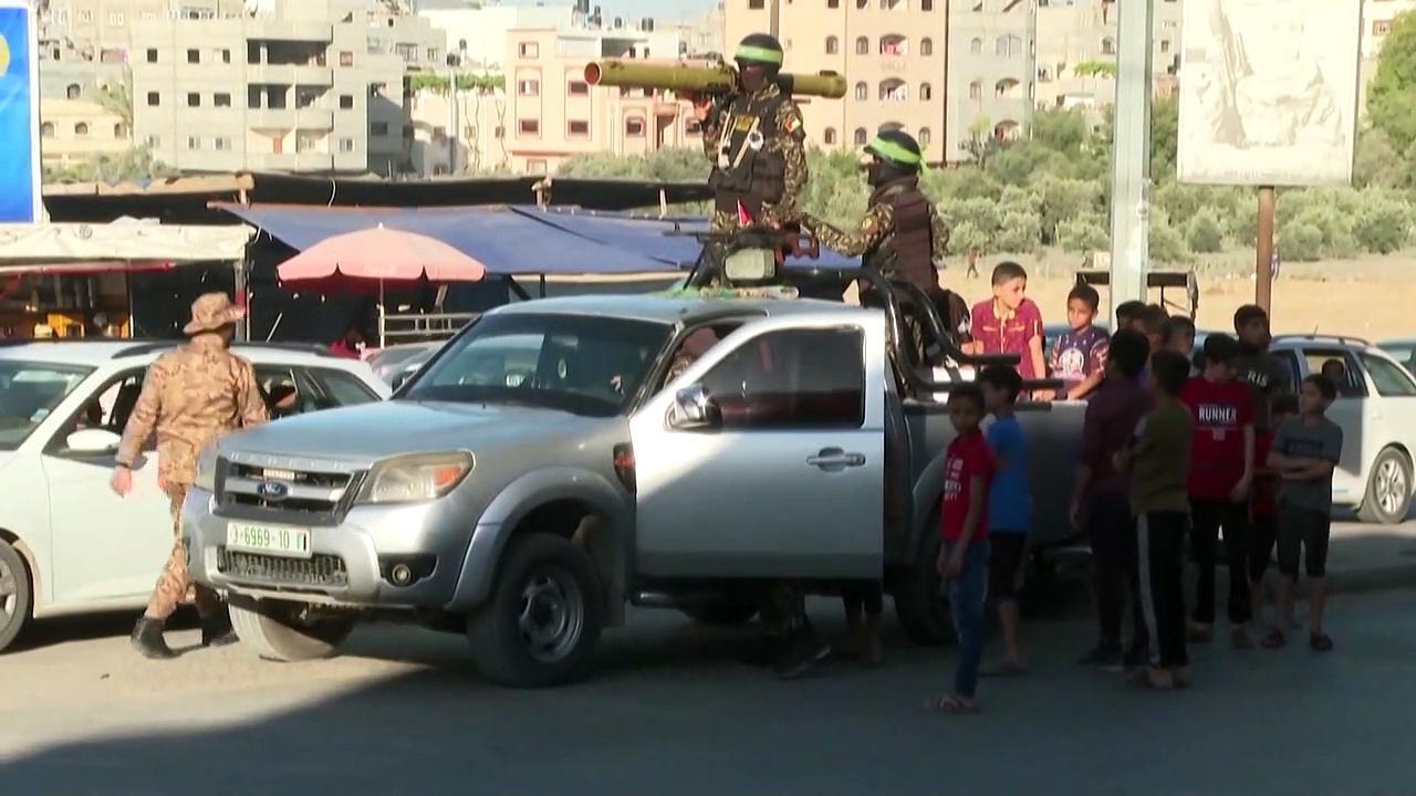 Members of Hamas' armed wing parade in Gaza City