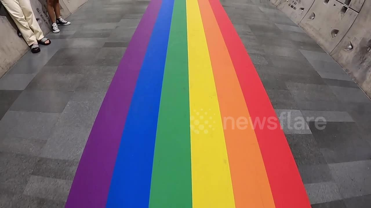 Walk through tunnel decorated with rainbow flag to mark Pride month in Bangkok