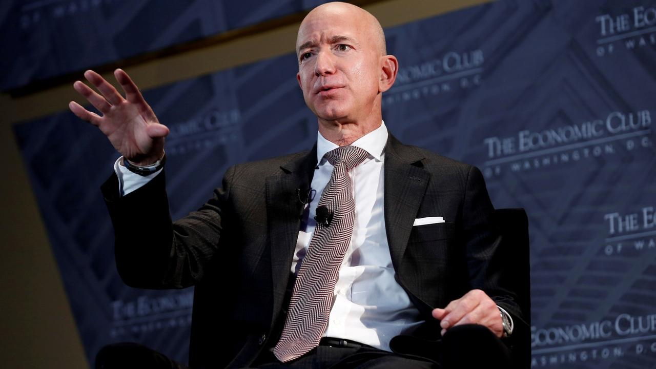 Bezos in space: Amazon CEO, brother claim seats on first flight