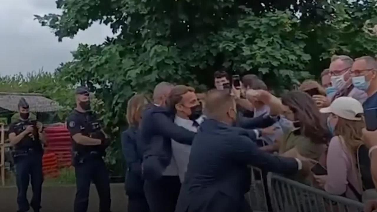 French president Emmanuel Macron slapped in face during visit to town