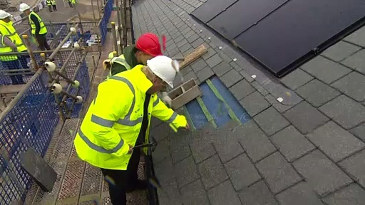 PM helps lay roof tiles in Cornwall housing development