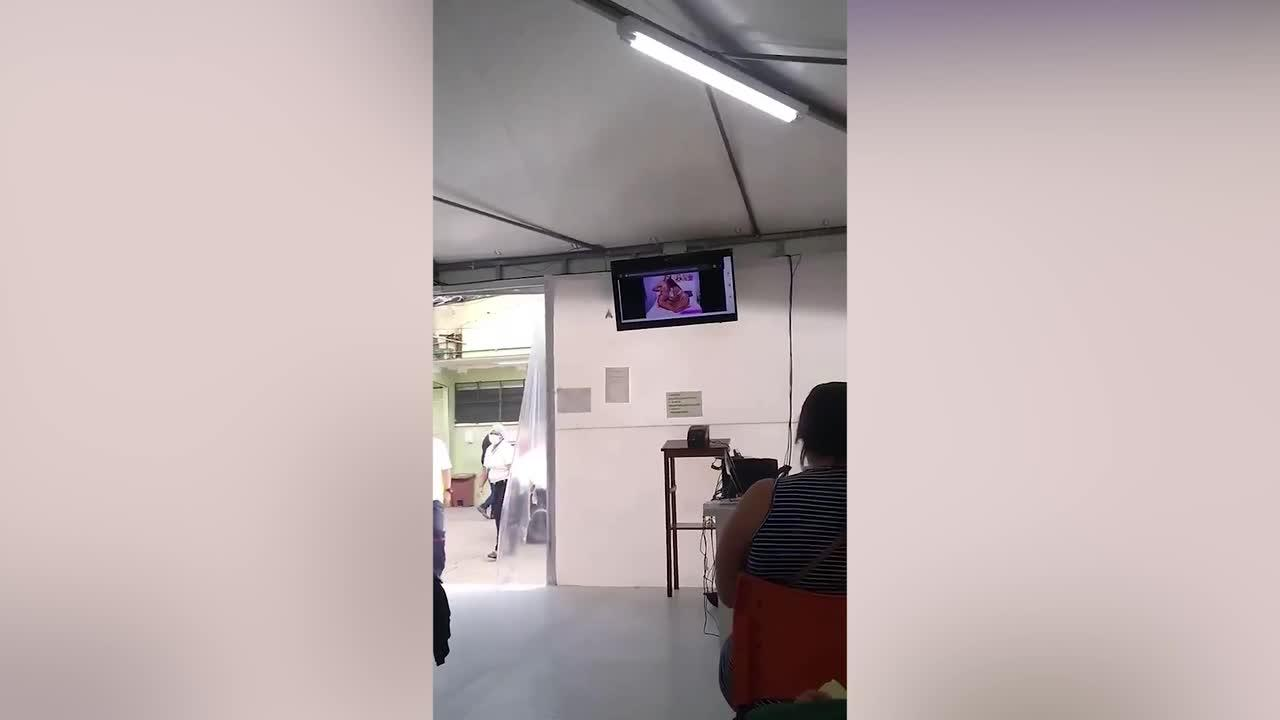 Girl-on-girl adult video plays on screen at Covid-19 vaccine centre in Costa Rica