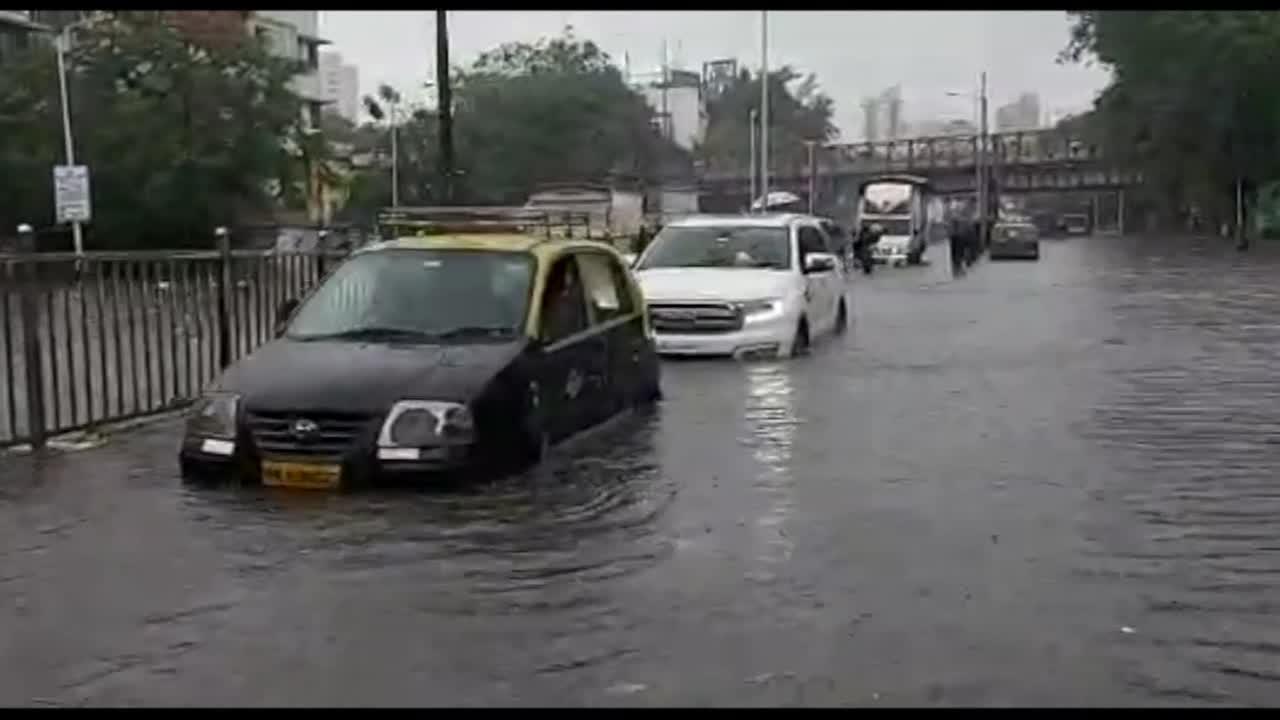 Motorists struggle to drive through submerged streets as flood hit Mumbai