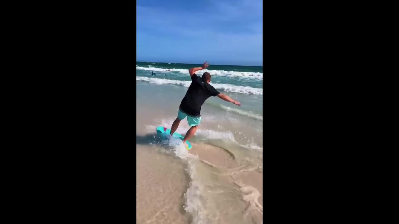 Florida wife documents her husband's bad attempt at skim boarding