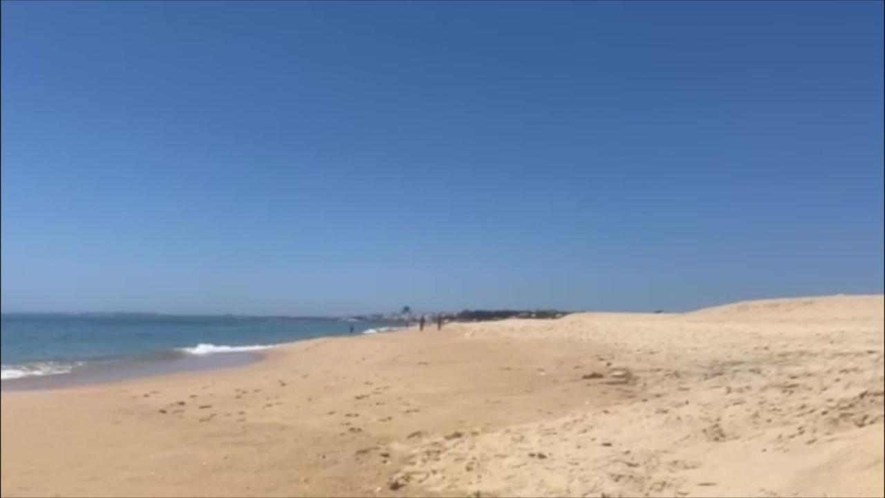 Nicole Scherzinger and boyfriend Thom Evans were spotted jogging down a beach in Portugal