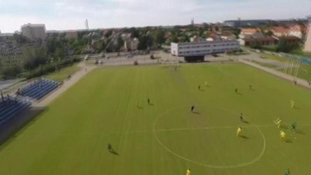 Parachutist crash-lands at football match