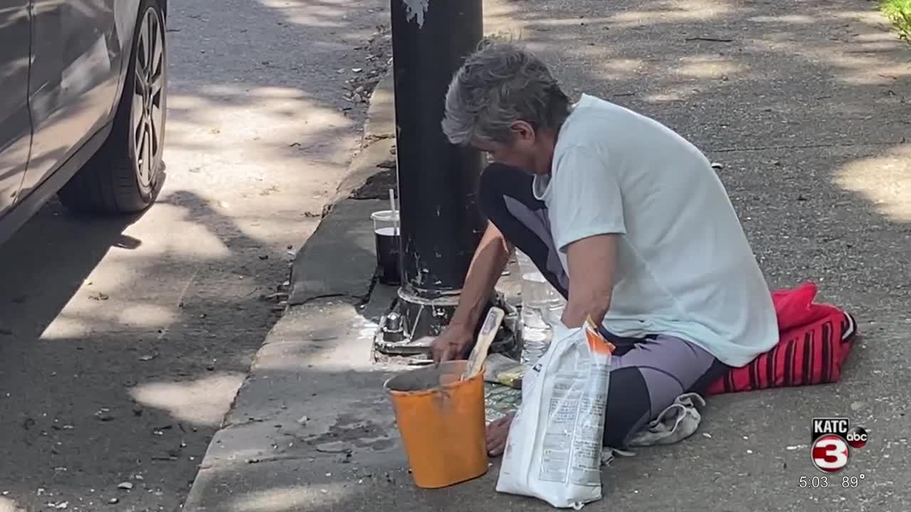 Artist uses broken tile to fix sidewalks