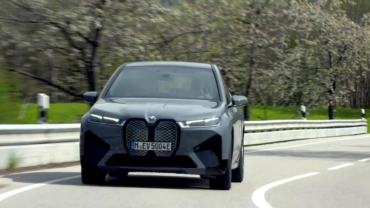 The first-ever BMW iX in Grey Driving Video