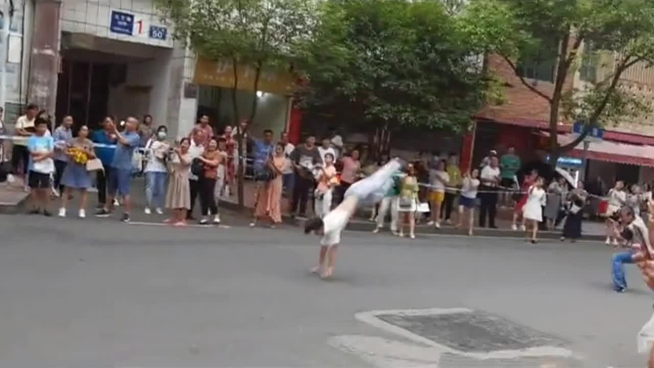 Excited boy somersaults out of exam centre after finishing university test in China