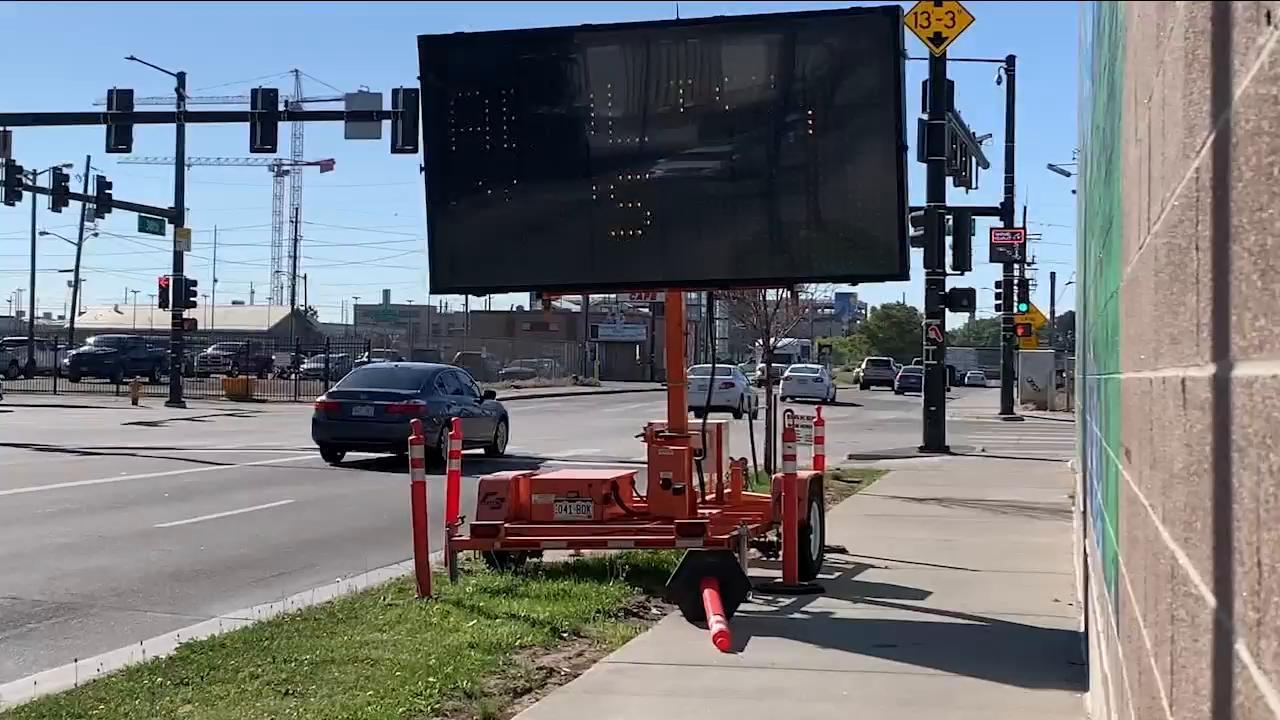 Hacked construction sign catches the eyes of morning commuters in Denver's RiNO neighborhood