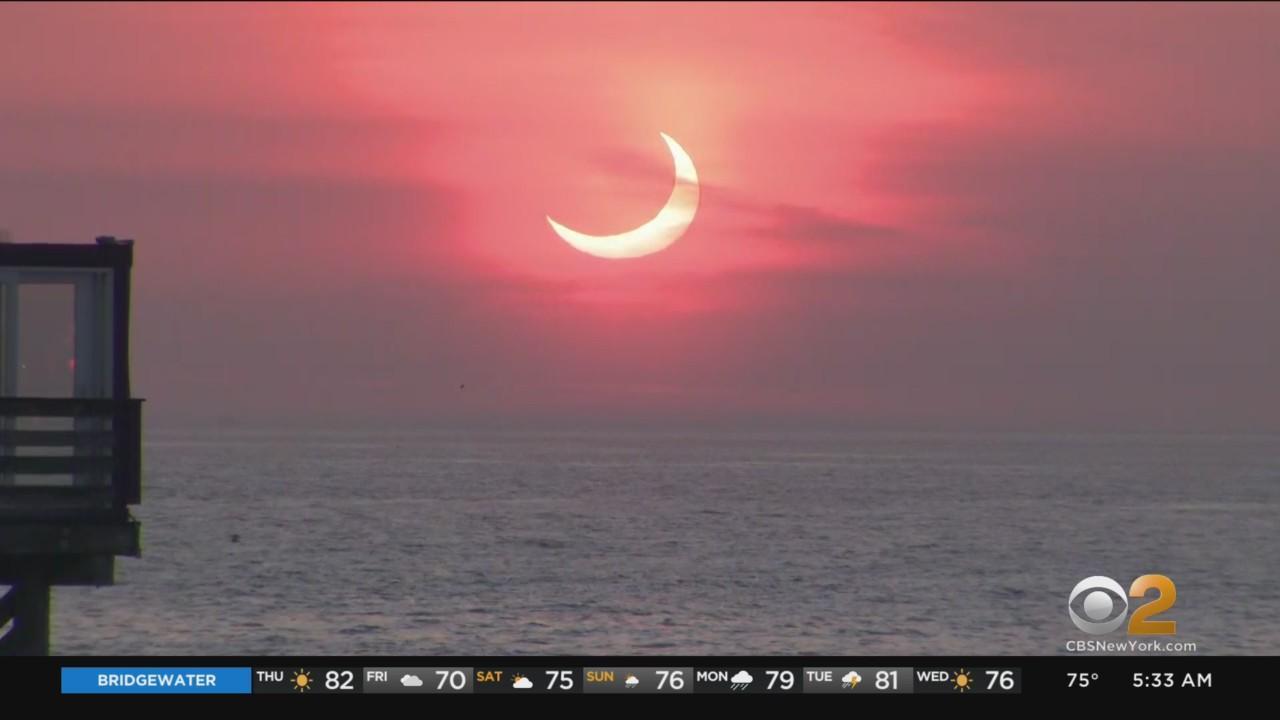 Spectators Take In Rare Sunrise Eclipse On Jersey Shore
