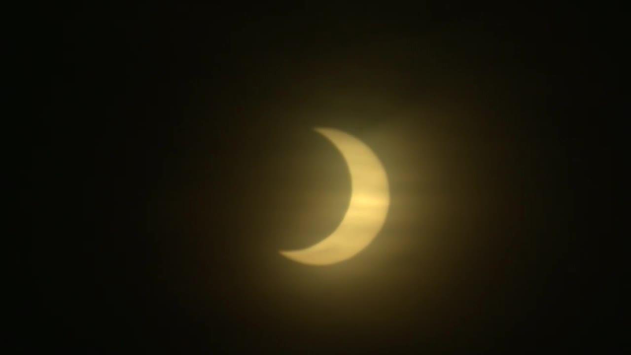 Partial lunar eclipse in sky over Boston