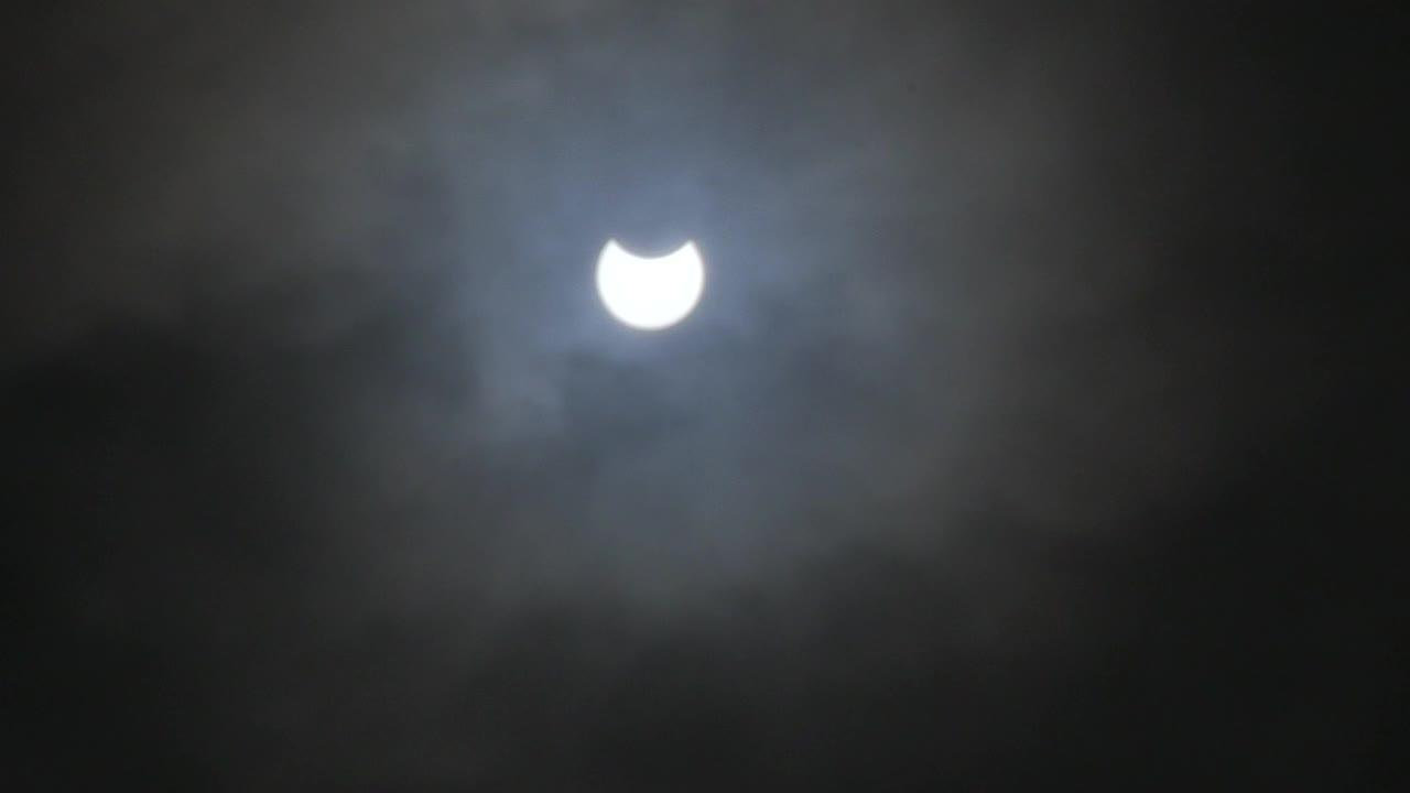 Partial solar eclipse visible in skies above Derbyshire, UK despite clouds