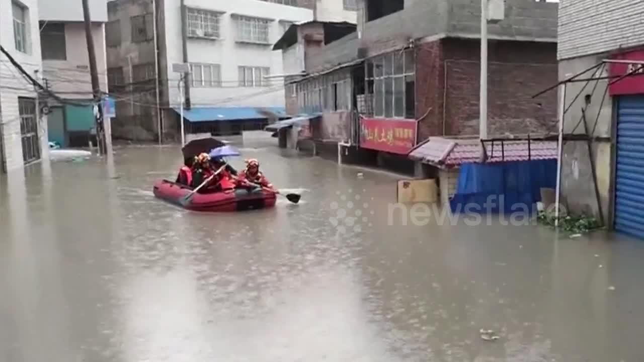 Chinese firefighters rescue people trapped in flooded buildings due to heavy rainstorm
