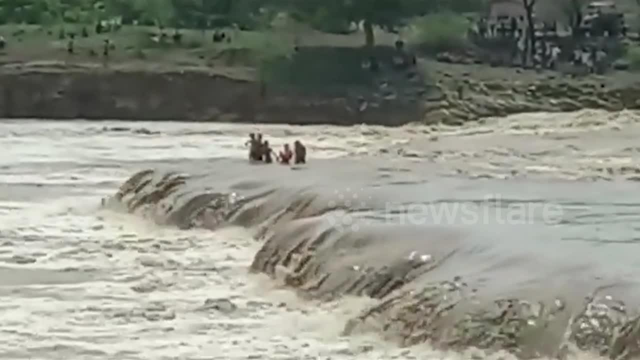 Four boys rescued from raging Indian river after hours-long ordeal