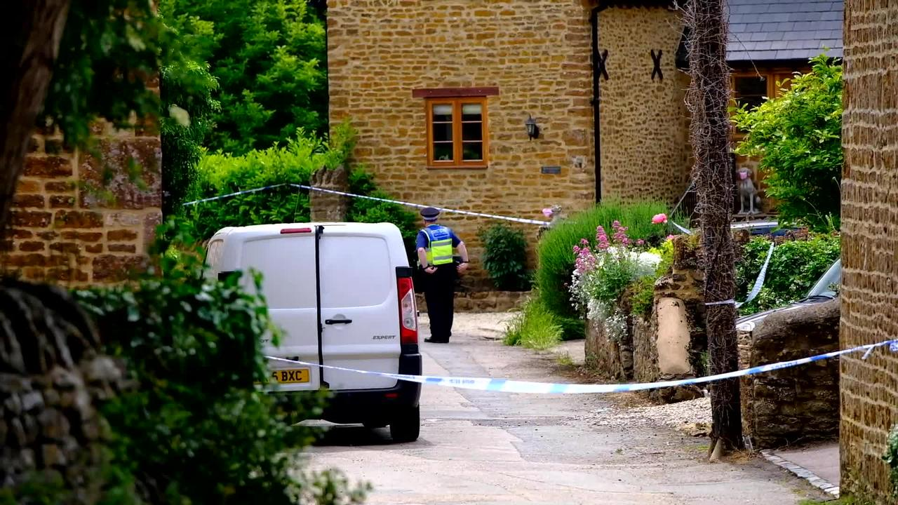 Woman arrested on suspicion of murder after man's body is found in a burnt out garden shed in picturesque village