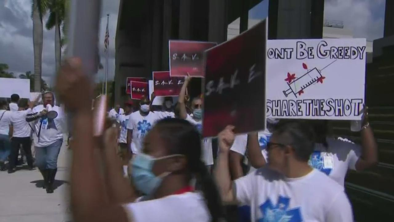 Protesters Gather In Fort Lauderdale To Demand The US Share COVID Vaccine With World
