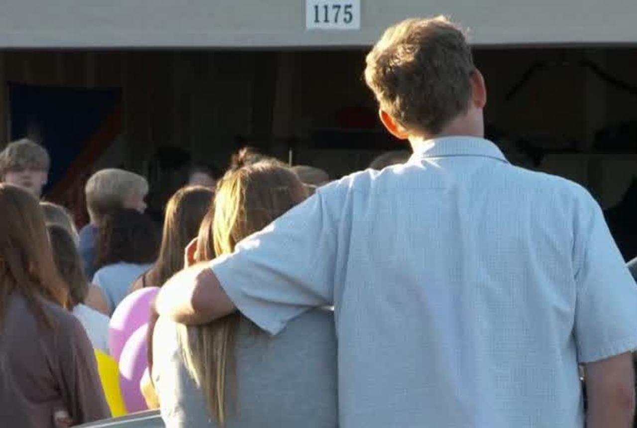 Vigil held for two teenagers killed in fiery crash
