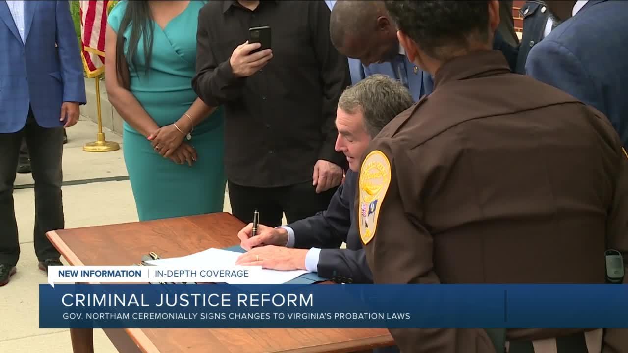 Northam signs probation reform bill alongside Meek Mill, Michael Rubin
