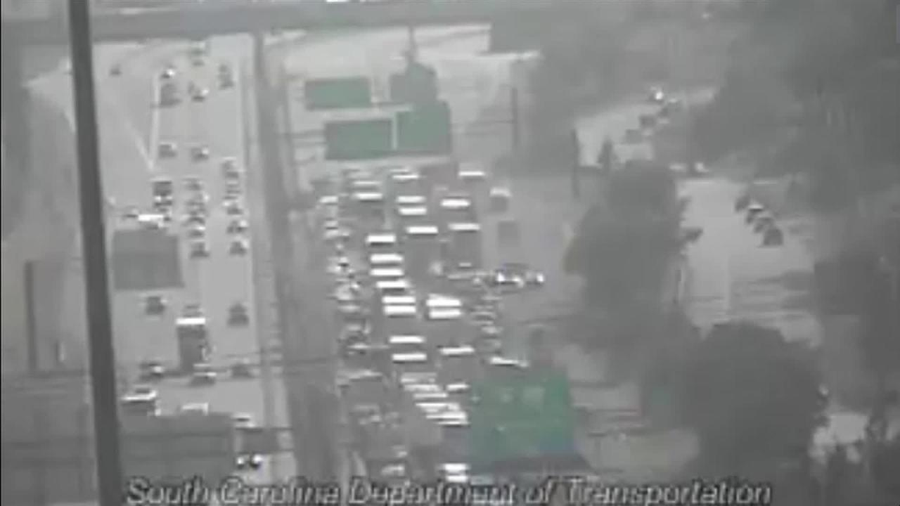 Crash with injuries blocks I-85 south in Greenville County, backs up traffic for miles