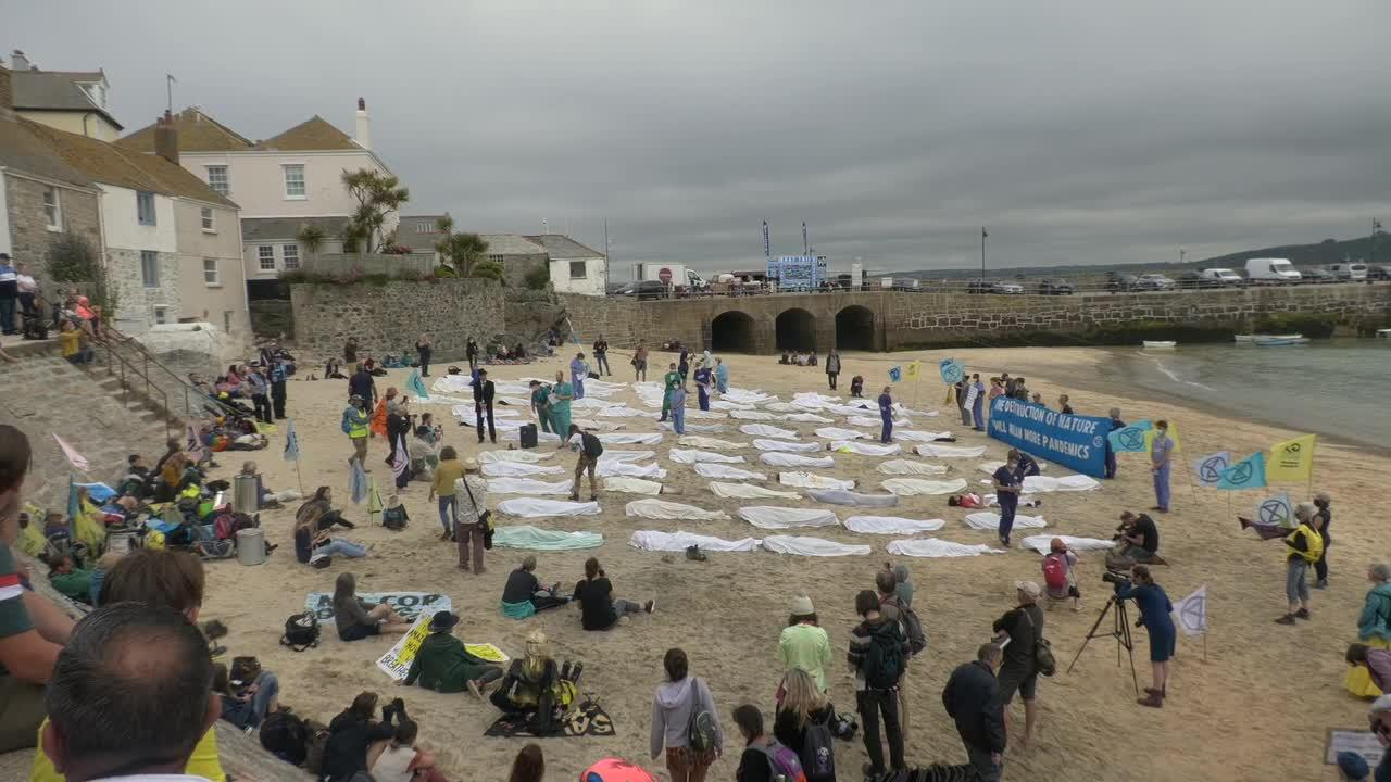 Environmental protesters place 'corpses' on St Ives beach at G-7 Summit