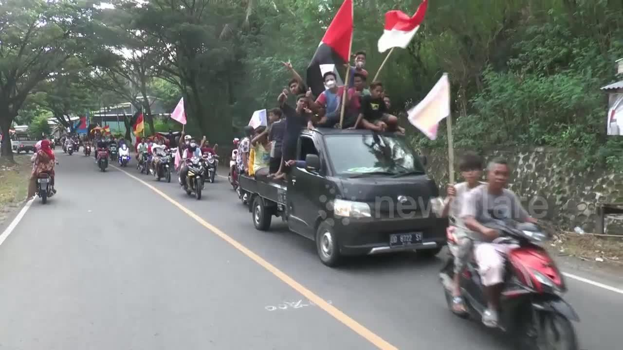 Welcome to Euro 2020: Thousands of Indonesian soccer fans carry country flags in convoy