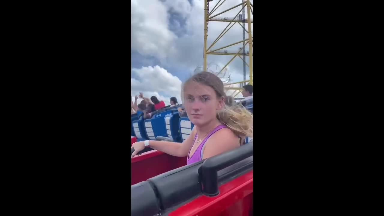 Friends see who can keep a straight face the longest on roller coasters
