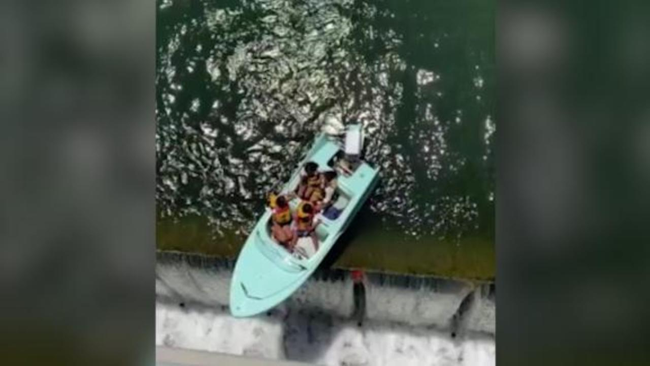 Video: Boat dangling from the edge of dam rescued