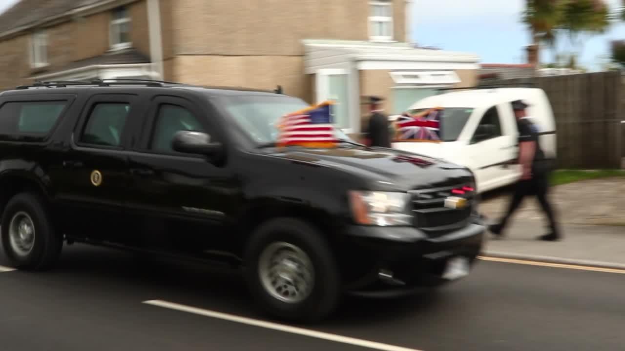 US President Joe Biden's motorcade passes Extinction Rebellion banners at G7 Summit