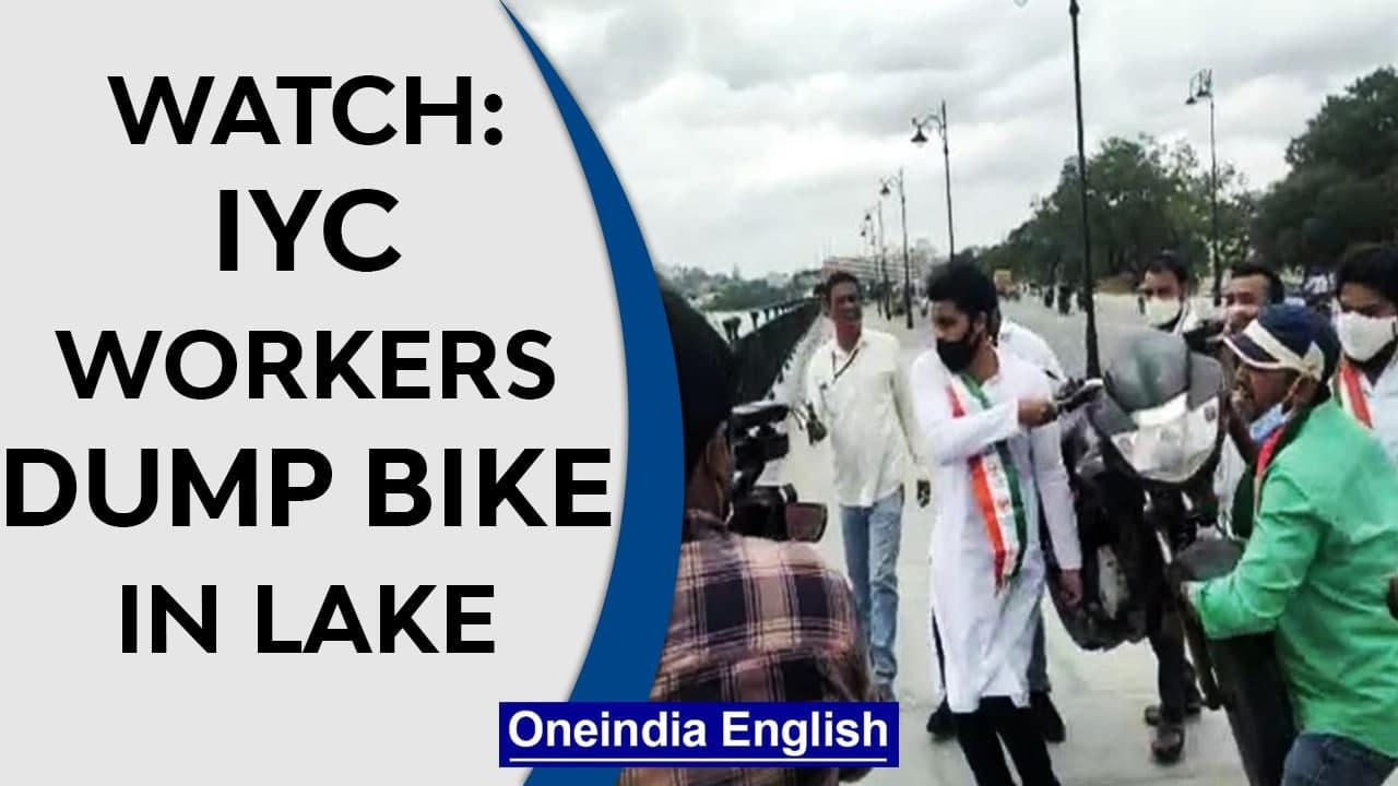 Hyderabad IYC workers throw bike in lake as a protest against rising fuel price |Watch|Oneindia News