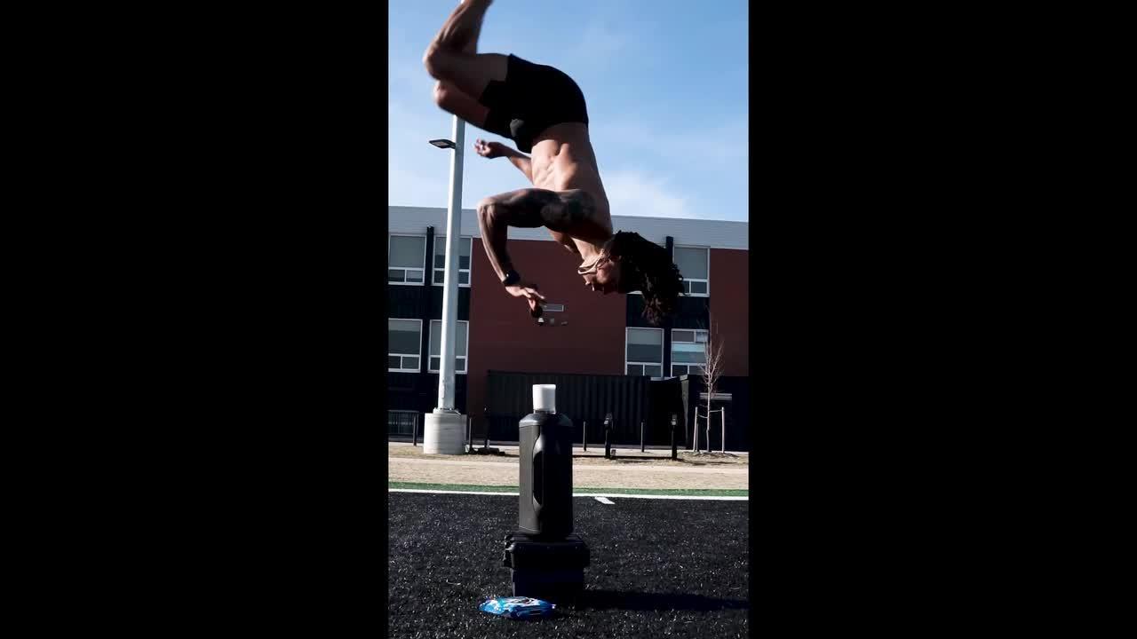 Professional American footballer dunks Oreo into milk mid-flip