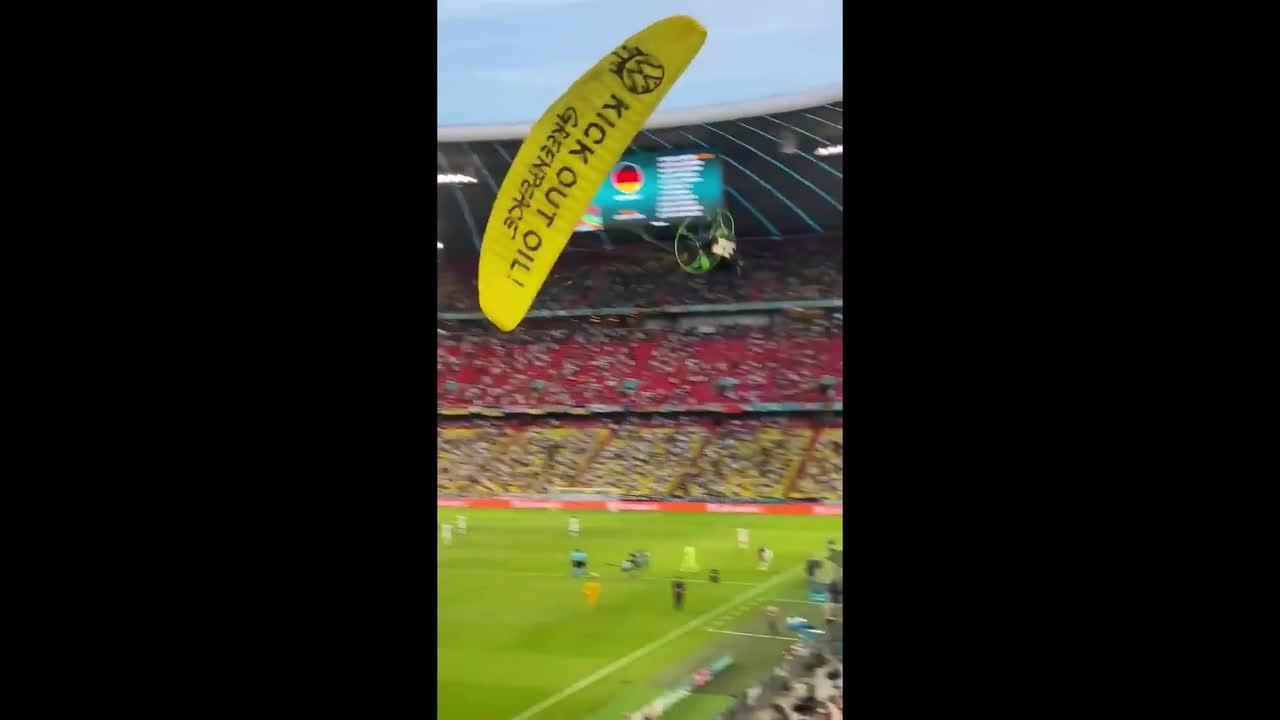 Greenpeace activist crash-lands onto pitch after hitting fans at Euro 2020 game