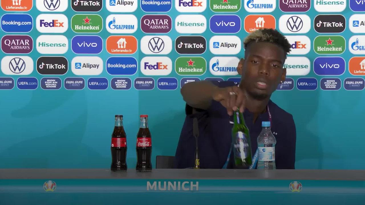 Pogba removes beer bottle from press conference table