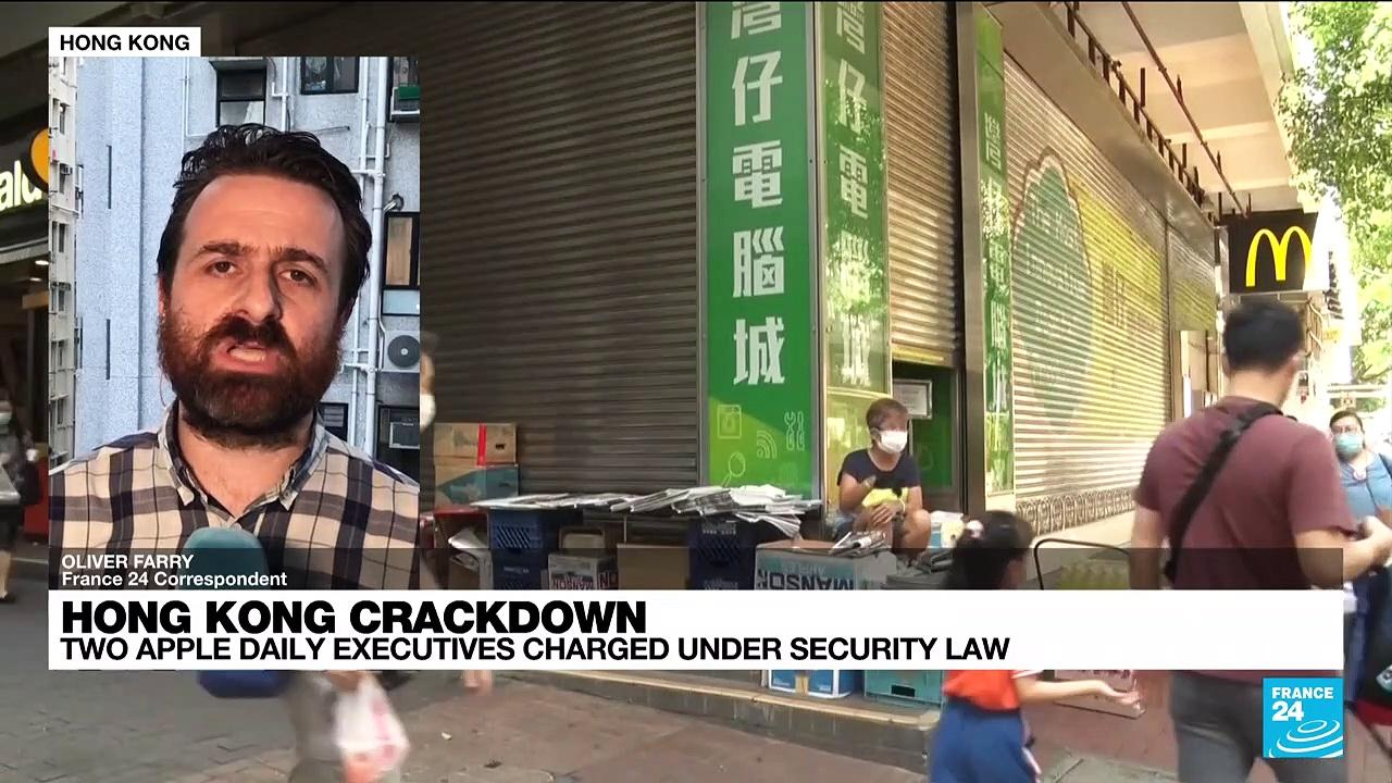 Two Hong Kong newspaper executives charged under security law