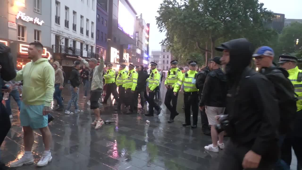 Scuffles in Leicester Square, London as England and Scotland football fans clash with police
