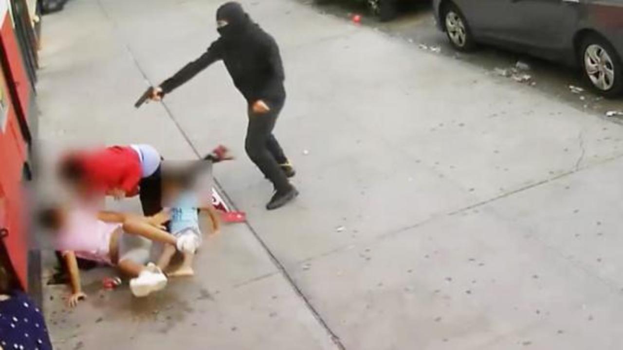 Terrifying video shows man shot next to children