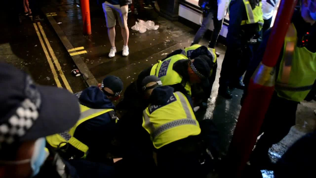Fans clash with police in London's Leicester Square during England-Scotland match