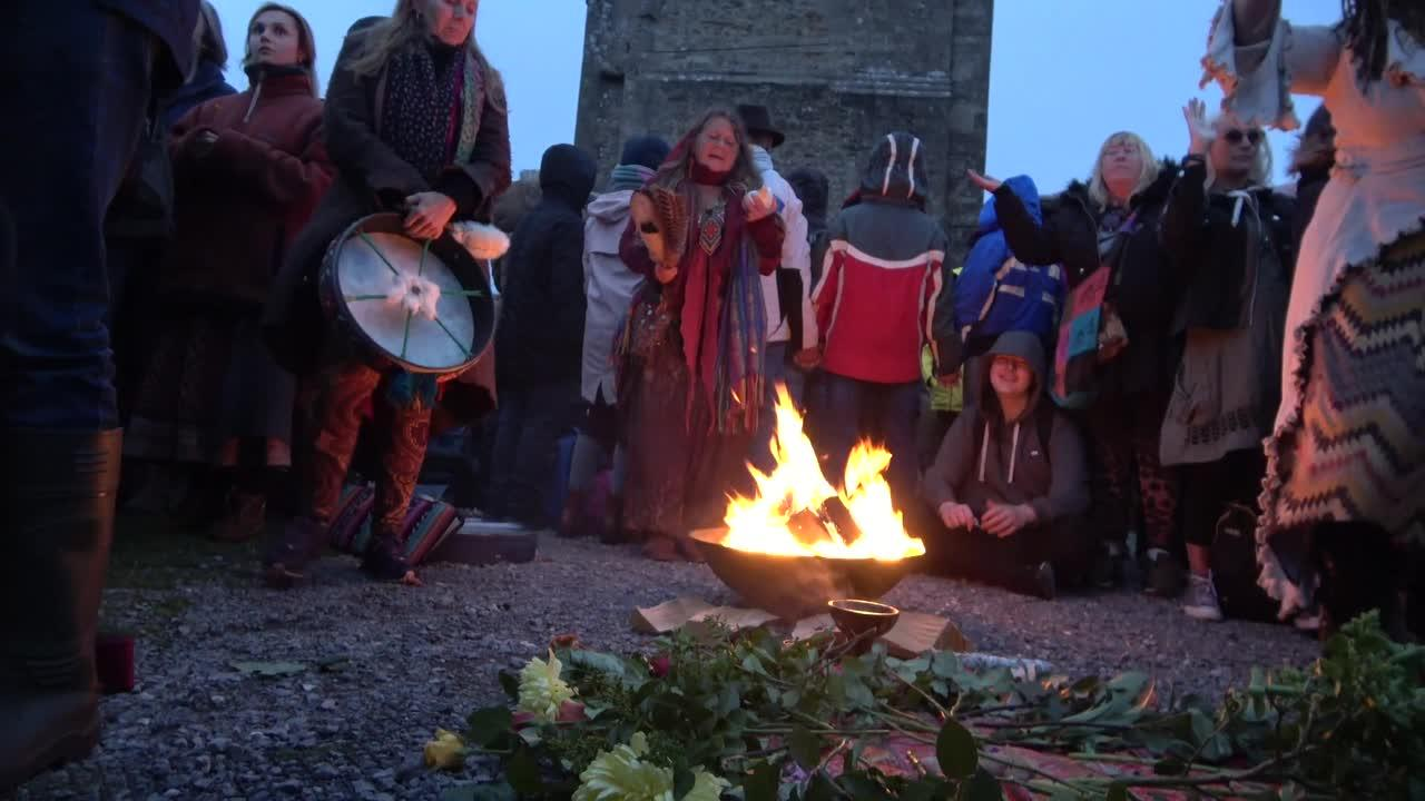 Daybreak celebrations at Glastonbury Tor summer solstice in spite of the overcast weather