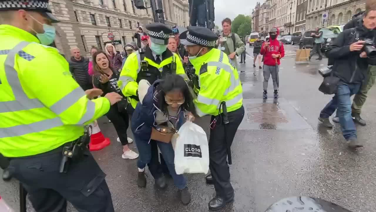 Arrest made as protesters clash with London police during anti-lockdown rally