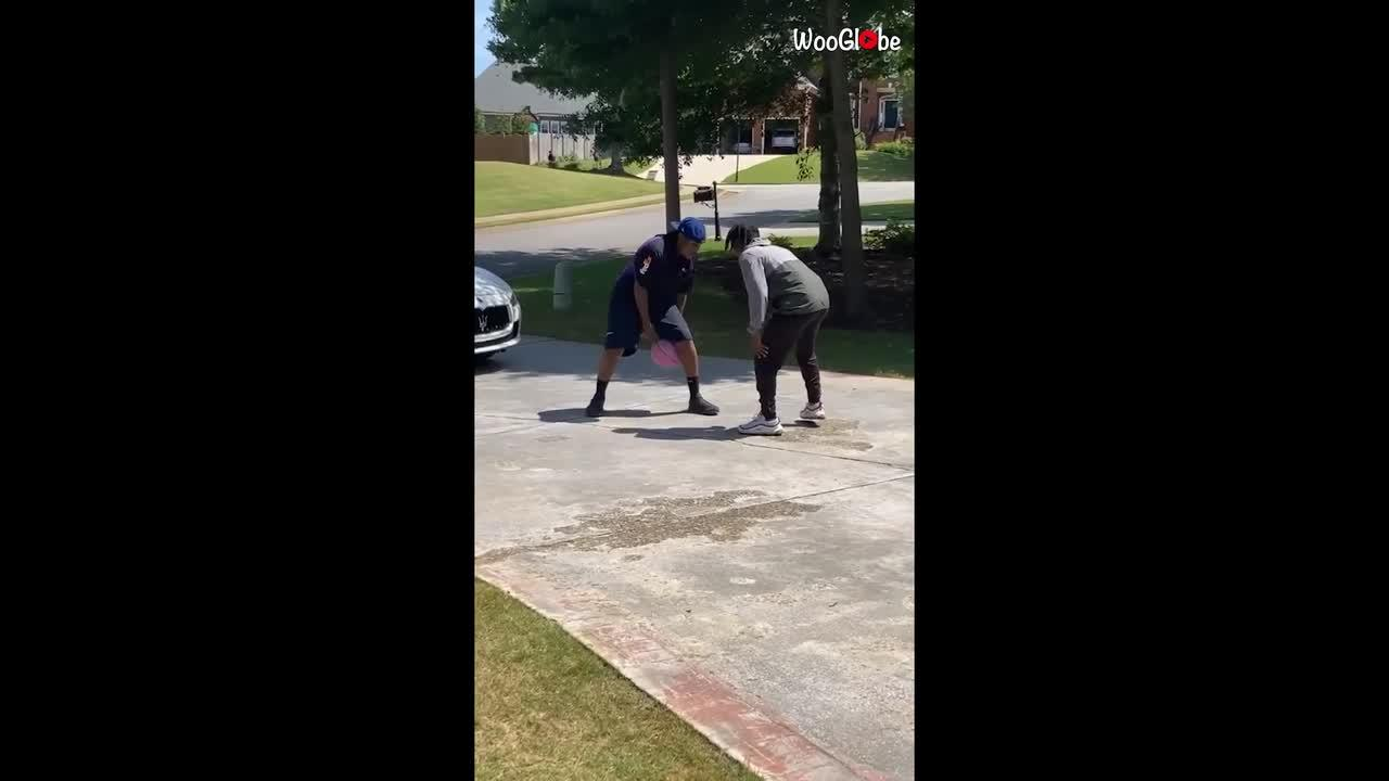 Delivery from deep! FedEx driver stops to play basketball after handing over package