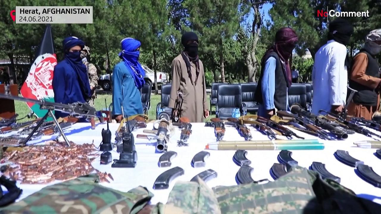 Taliban fighters surrender weapons at government ceremony
