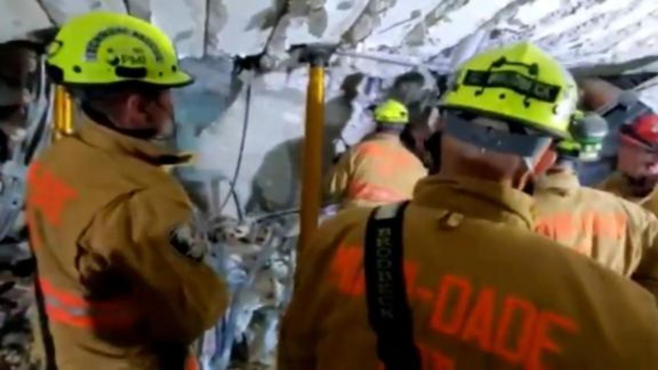 Video shows rescuers working to find people trapped under rubble