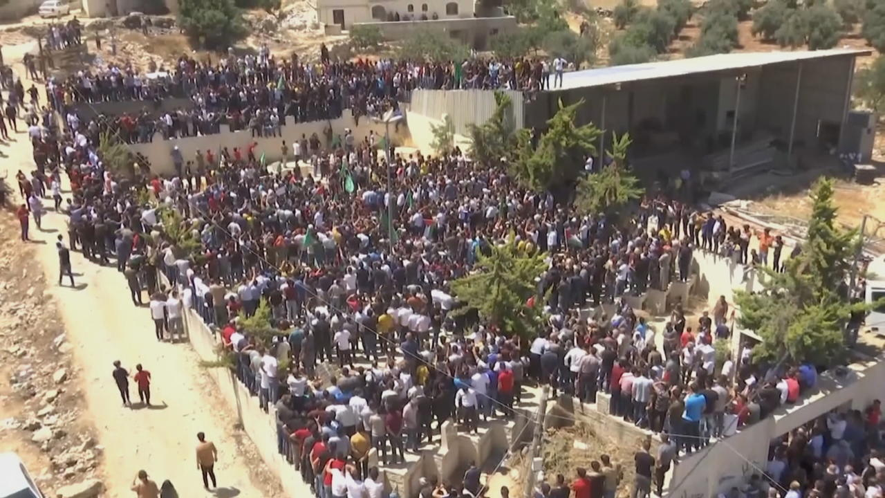 Palestinians attend funeral for PA critic Nizar Banat in Hebron