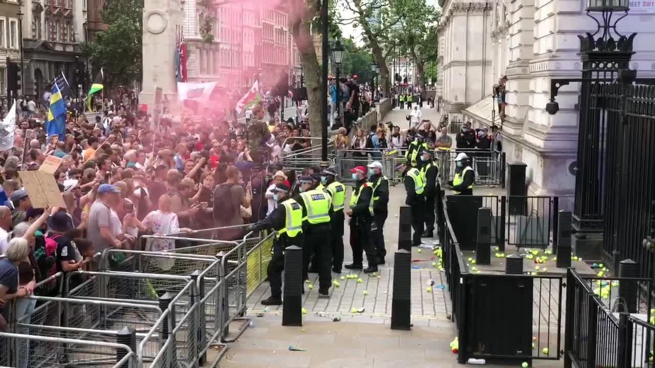 Bottles, tennis balls thrown at police by anti-lockdown protesters outside Downing Street