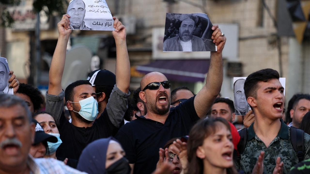 Rival Palestinian groups clash at protest over activist's death
