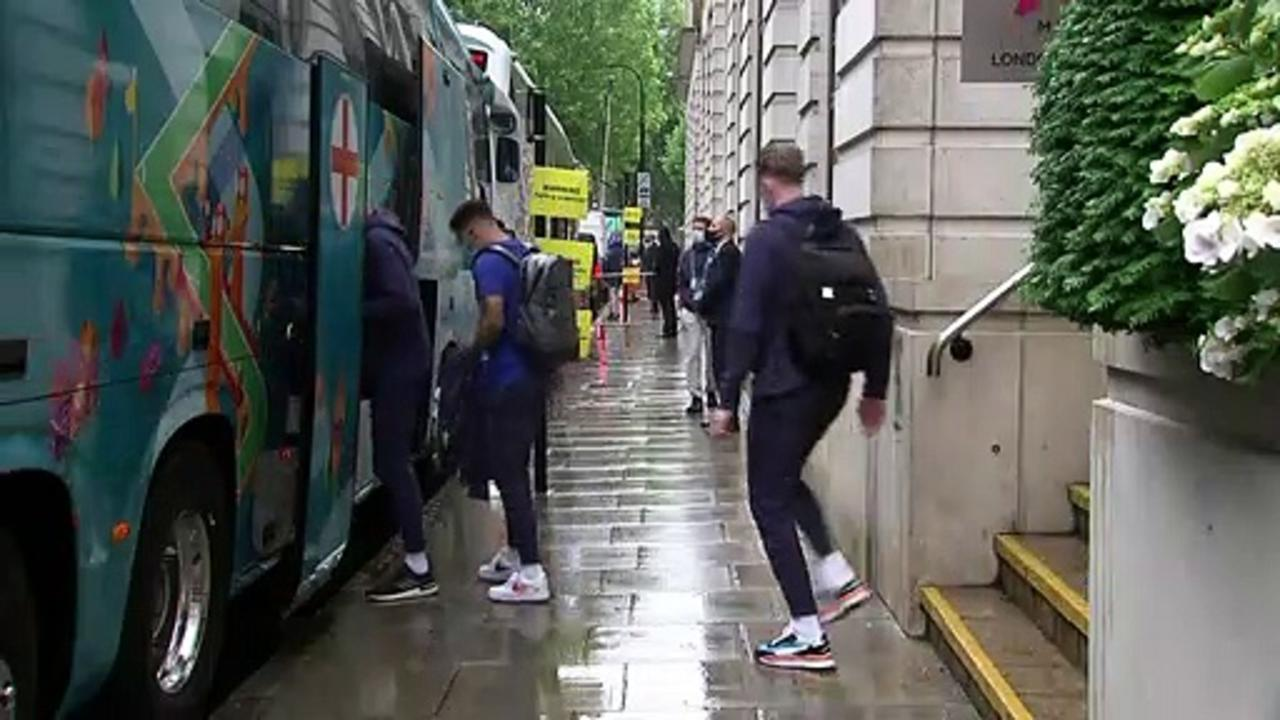 Fans cheer as England players head to Wembley