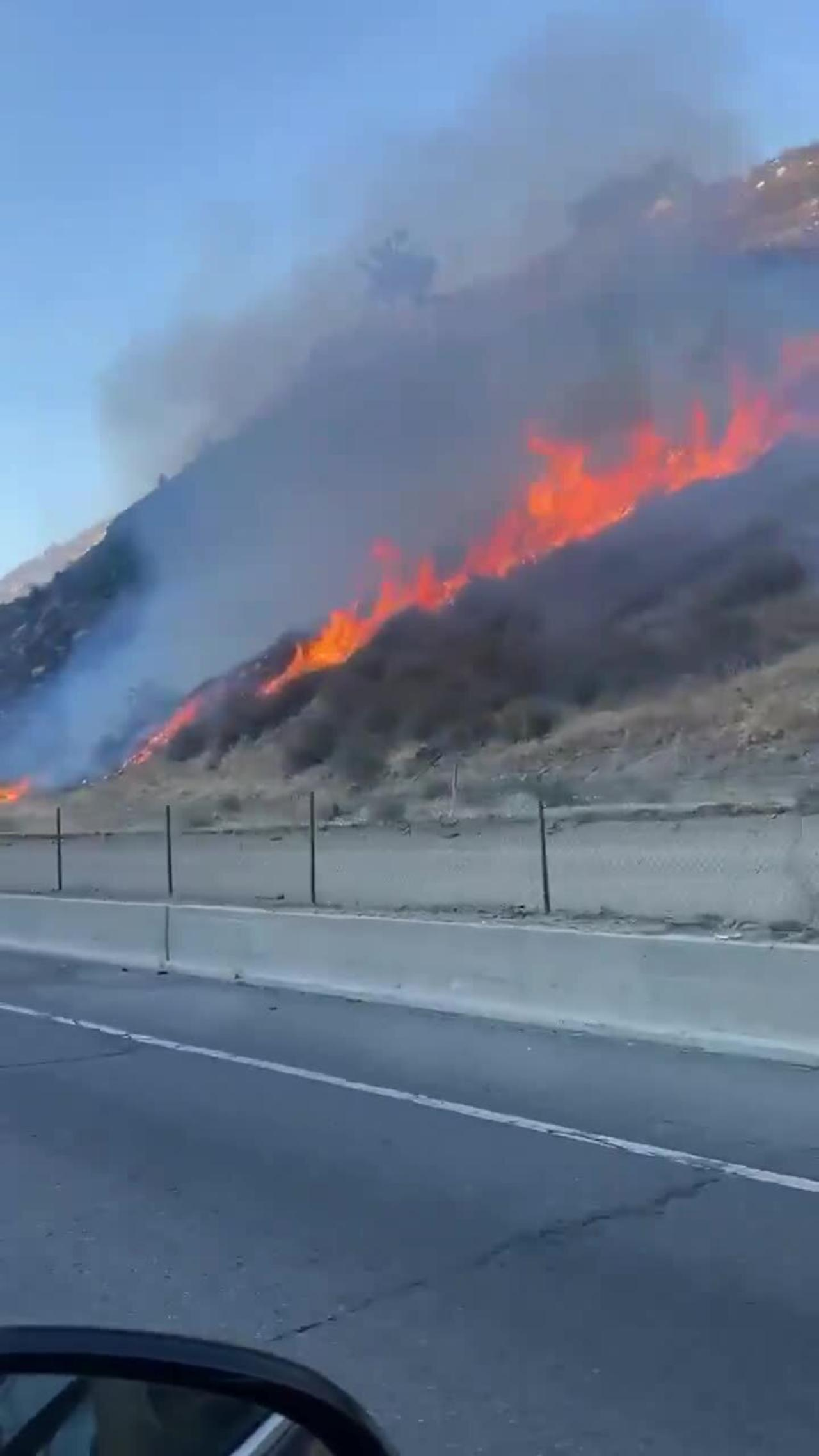 California wildfire rages right next to highway