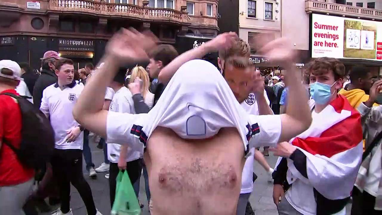 Football fans celebrate England win in Leicester Square