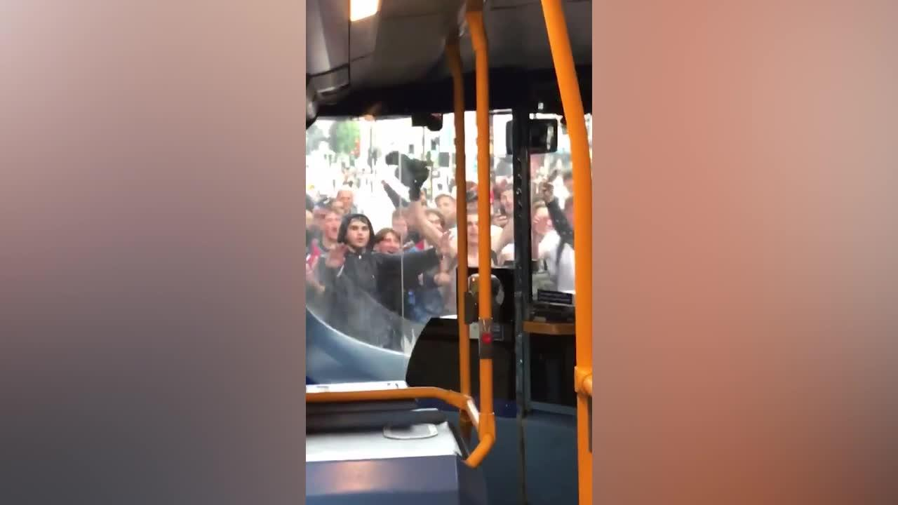 England supporters hurl themselves into BUS while celebrating Euro 2020 win over Germany